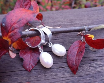 Silver earrings with freshwater pearls.