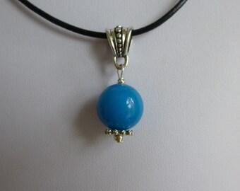 Blue quartzite bead pendant on  black leather cord.  14mm quartzite bead