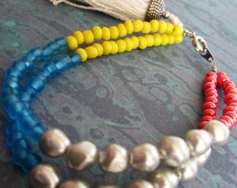 Double Stranded Beaded Bracelet with Tassel