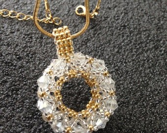 Beautiful bead weaved Crystal pendent with gold chain...