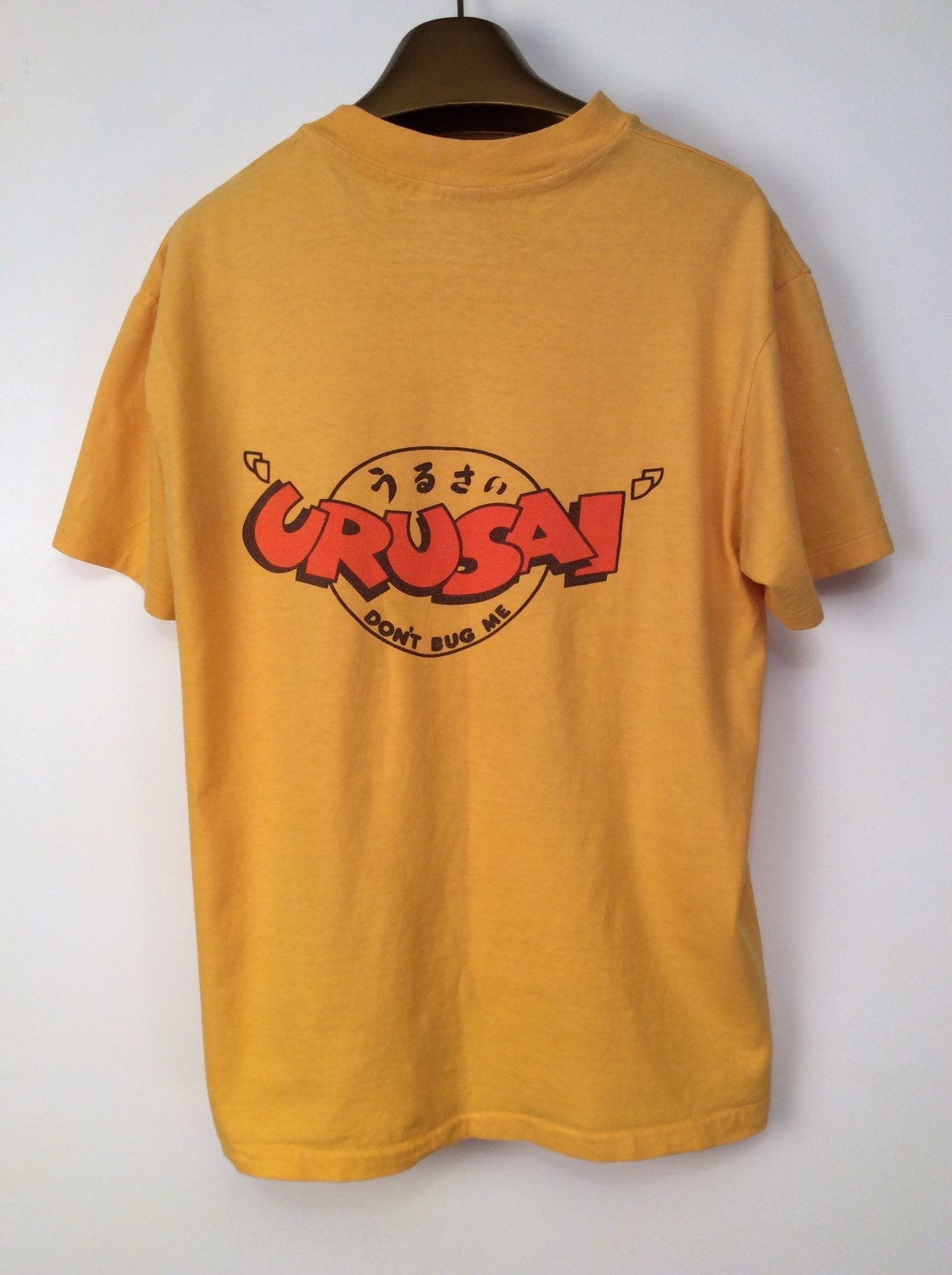 Vintage graphic t shirt crusai logo on back yellow t shirt sz for Shirts with graphics on the back