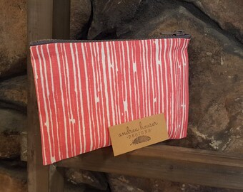 Coral and white zippered bag