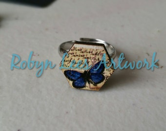 Dark Blue Butterfly Printed Wooden Hexagon Ring with Writing Parchment Style Background on Adjustable Silver Ring