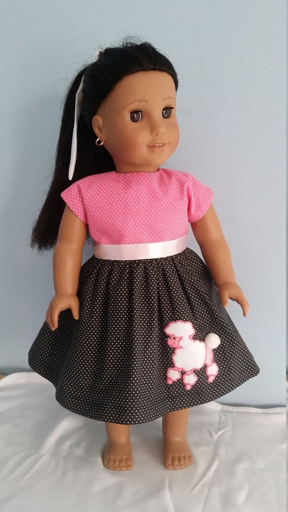 1950s style poodle skirt outfit. Also includes hair