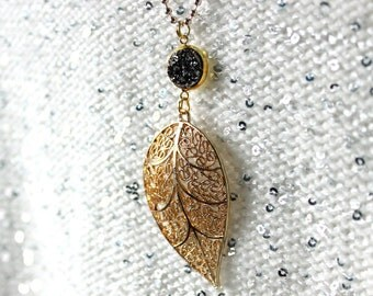 Golden leaf necklace LEAF LAVA cabochons brilliant black