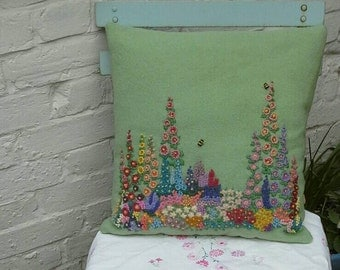 Hand embroidered cushions made from vintage wool blankets.