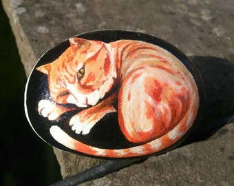 Ginger cat painted pebble paperweight