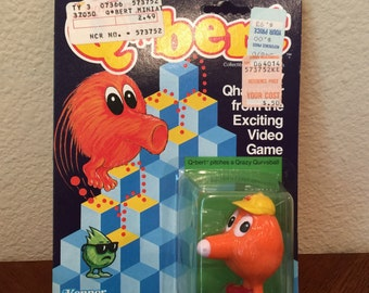 Qbert pitches a Qrazy Qurveball Figure