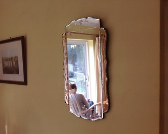 Beautiful vintage bevel edged Art Deco wall mirror with rose coulored glass panels and etched designs. 1940's