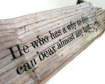 """Nietzsche driftwood engraving """"He who has a why to live can bear almost any how."""""""