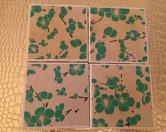set of four handmade green and white floral coasters