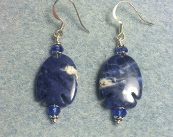 Blue sodalite gemstone fish bead earrings adorned with blue Chinese crystal beads.