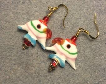 Red, pink, blue and white lampwork angelfish bead earrings adorned with red Czech glass beads.
