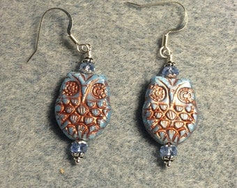 Light blue with copper wash Czech glass owl bead earrings adorned with light blue Chinese crystal beads.