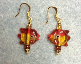 Red and gold lampwork fish bead earrings adorned with red and gold Czech glass beads.