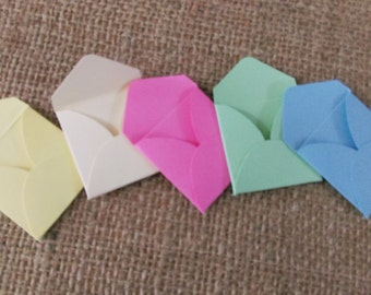 mini envelopes, tiny envelopes, for invites, for scrapbooks, cardmaking crafts, pastel coloured embellishments, pink, mint, baby blue, cream
