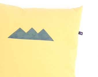 Yellow pillow with crown