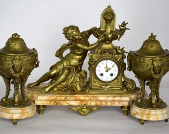 19th Century French Gilt Spelter Clock and Urns