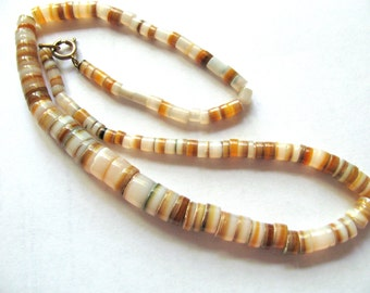 Shell necklace, Gold Lip shell, graduated strand, 18 inches long, gold color clasp, beads 4x5mm, to 8x10mm -  B 317