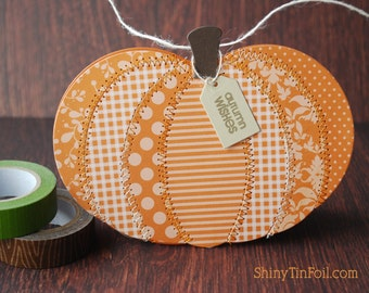 Cute handmade pumpkin card.  patterned papers machine stitched card
