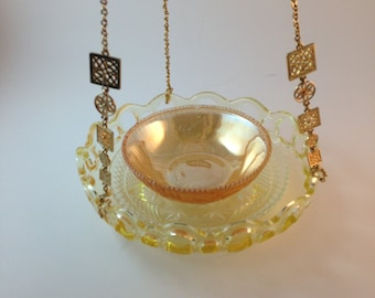 Vintage yellow jubilee bowl, lusterware bowl and vintage necklace as the hanger Gorgeous