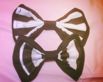 Medium Black and white striped bow.