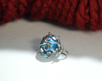 Transparent Blue Ball Wrapped with a Sterling Silver Lady Bug Design CHARM