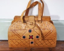 Vintage tan tooled leather box bag with gold stars and camels