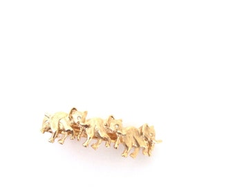Three marching elephants with rhinestone eyes  hair clip. Gold tone metal barrettes. Made in France.