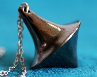Inception spinning top totem necklace