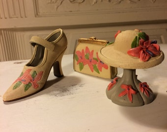 Miniature Shoe, Clutch, and Hat on Stand.