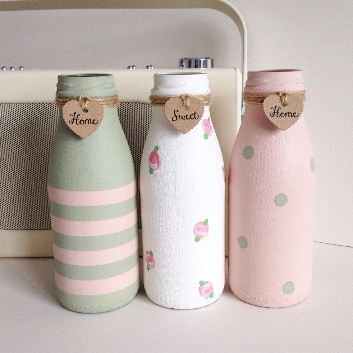 Set of three hand painted mini milk bottles