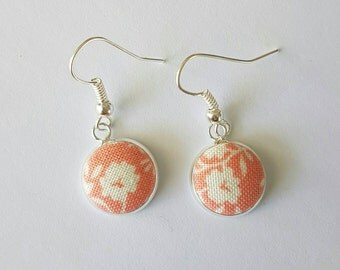 Peach floral fabric drop earrings.