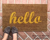 Hello welcome mat. Hand painted, customizable doormat gives your visitors a warm and colorful greeting.