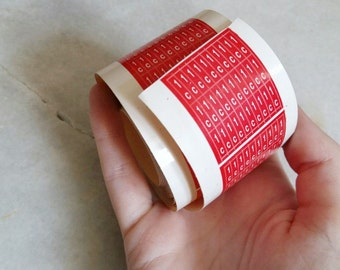 Roll of red stickers for shingles