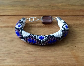 Handmade bead crochet bracelet with geometric pattern