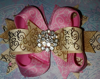Pink swirls and foil hairbow