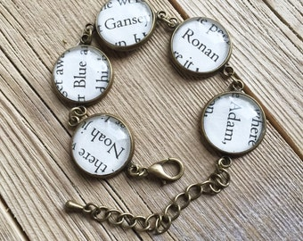 Up-cycled book page bracelet from the pages of the Raven Cycle series. Ronan, Adam, Gansey, Blue, and Noah
