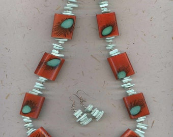 Eye catching necklace in orange and turquoise with matching earrings