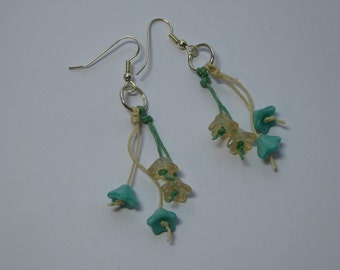 Cream and turquoise drop earrings.