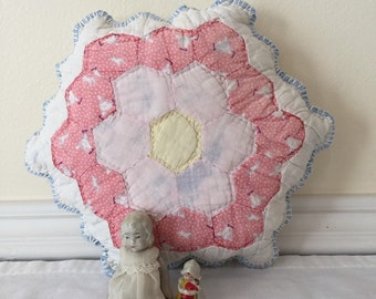 Decorative flower pillow hand stitched from a vintage quilt