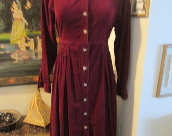 Fads 100% cotton pinwale corduroy burgundy long sleeved full button front dress. Vintage. Made in Hong Kong circa 1980. Size 10.