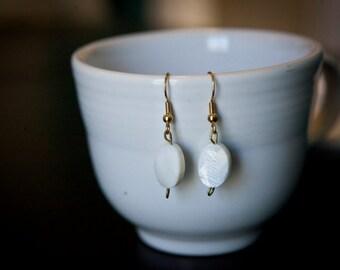 White oval bead earrings