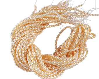 15 1/2 IN Strand 2-2.5 mm Freshwater Pearl Rice Shaped Peach Color (FRCPCH0025)