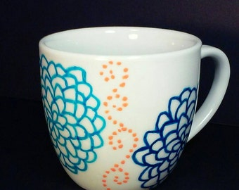 11 oz White Coffee Mug with Hand Painted Blue Flowers and Orange Dotted Swirls