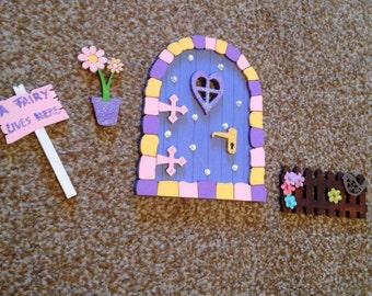 Fairy door with picket fence