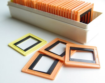 Vintage slide frame set of 36 in original plastic box, orange, yellow and black colour, Soviet diapositive photo frames, made in USSR