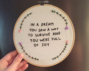 "hand embroidered jenny holzer truism 7"" hoop"