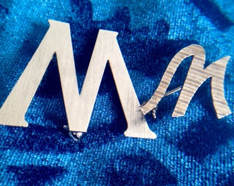 """Large and Small Silver Letter """"m"""" Brooches"""