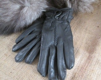 Ladies Black Leather Gloves with a Snap Button at the Wrist. Size Large.